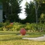 red urn in summer landscape